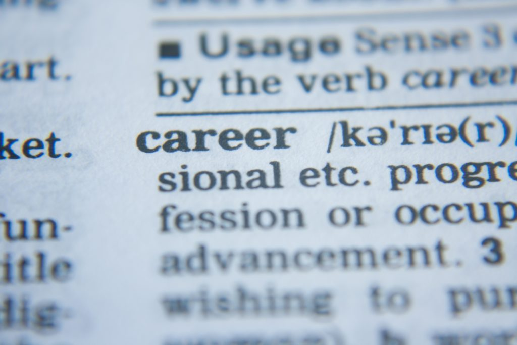 "Image of lots of black text on a white piece of paper, zoomed in on the word ""career""."