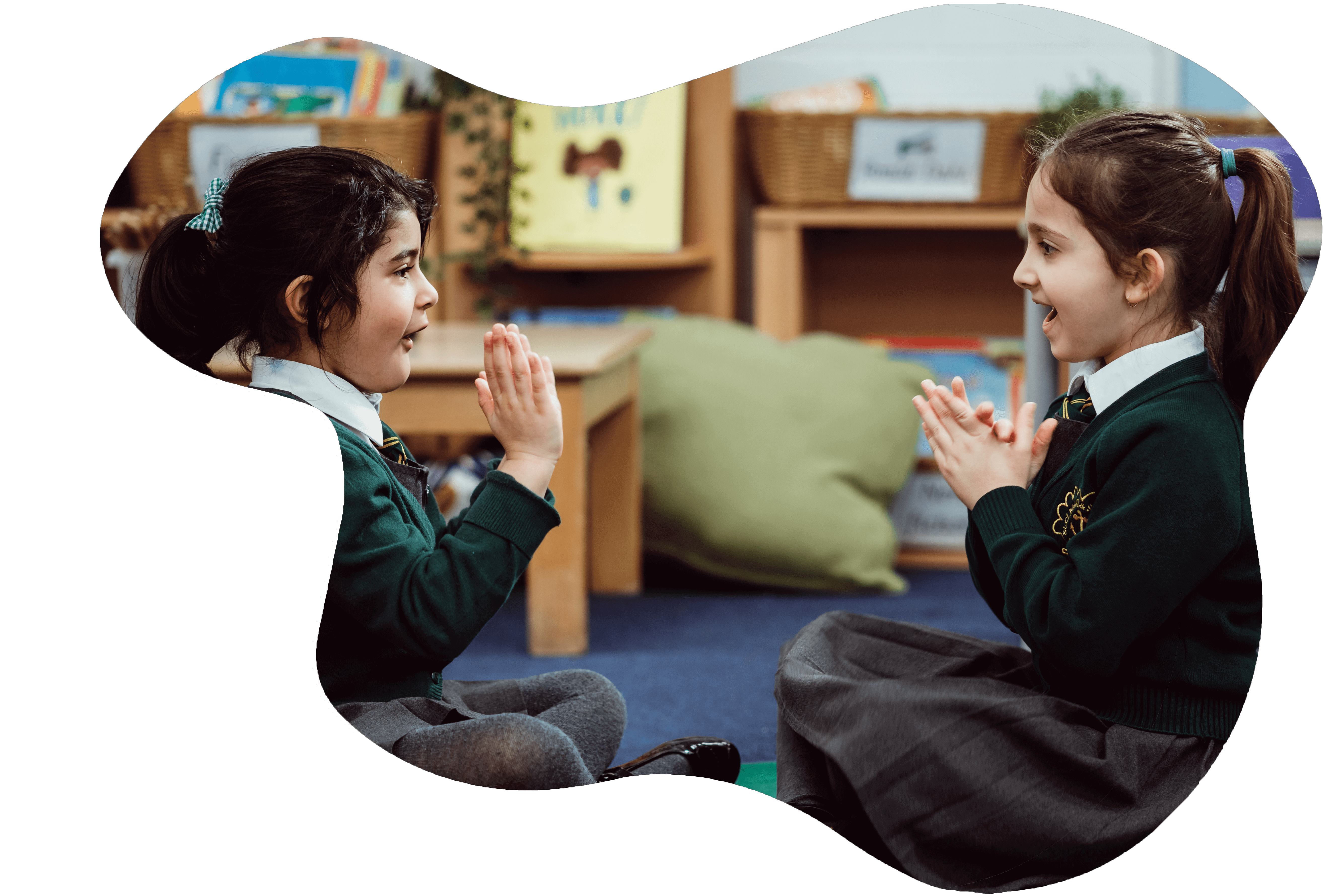 Two girls playing a clapping game