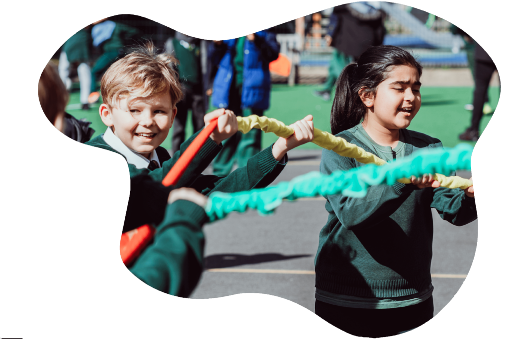 children playing outside with a stretchy rope